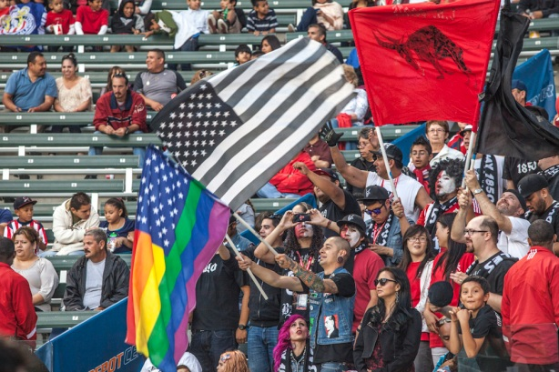 Black Army 1850 during the game, waving a rainbow-colored flag to promote it accepts any fan to join their ranks.